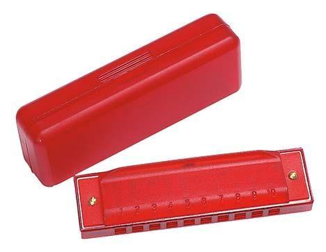 Rote Mundharmonika in roter Kunststoffschachtel